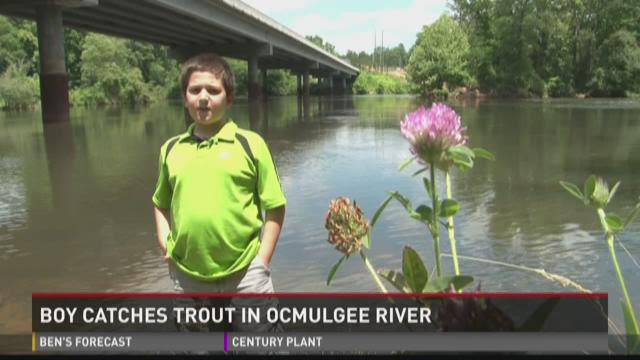 boy catches trout in Ocmulgee River
