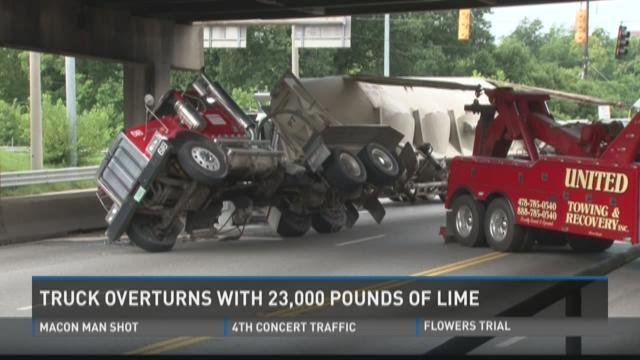 Truck overturns on Spring Street in Macon