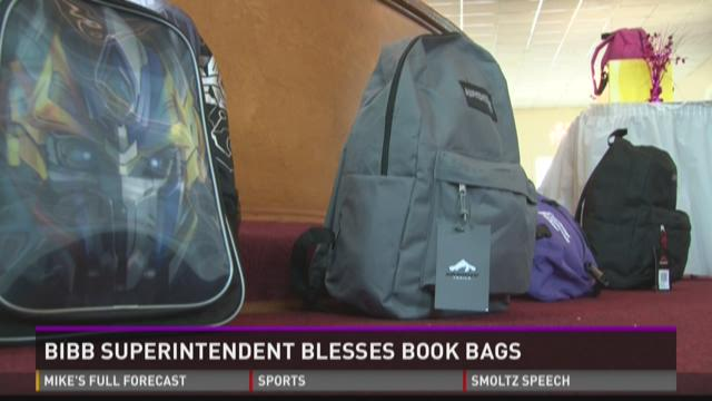 Bibb superintendent gives bookbags away