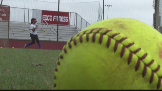 WATCH: Veterans softball weathers the storm